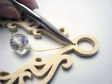 Push Knot Into Scroll Saw Ornament Hole