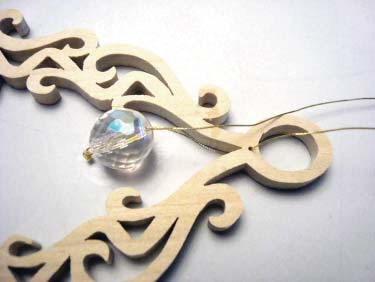 Attach Bead To Scroll Saw Ornament